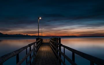 lamp post turned on at brown wooden dock All Mac wallpaper