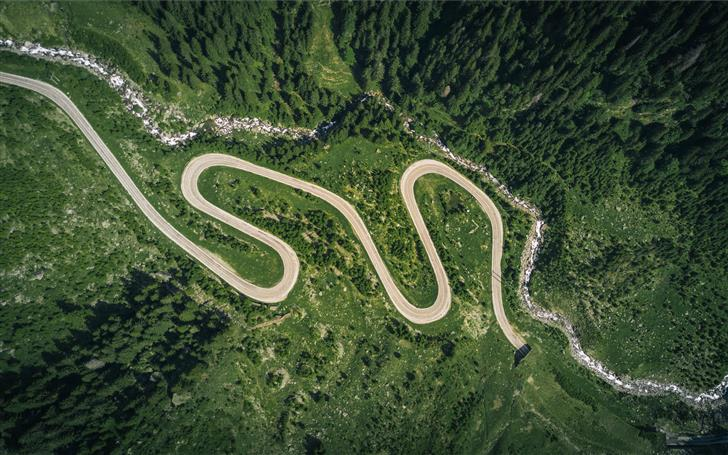 aerial view of asphalt road surrounded by trees Mac Wallpaper