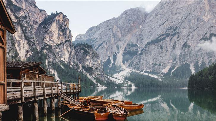 boat docked near house Mac Wallpaper