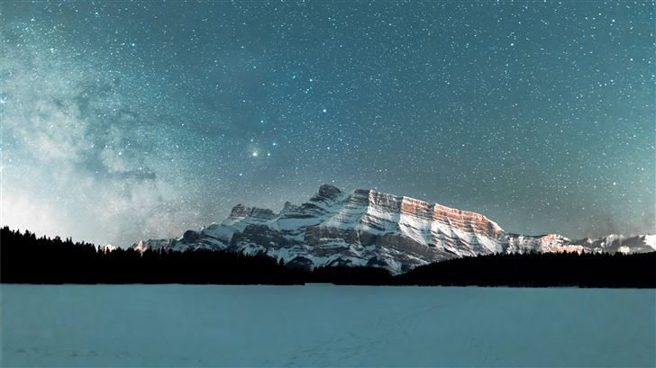 snow covered mountain under starry night Mac Wallpaper