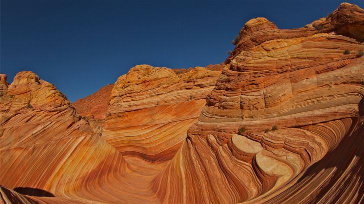 brown rock formation under blue sky during daytime Mac Wallpaper