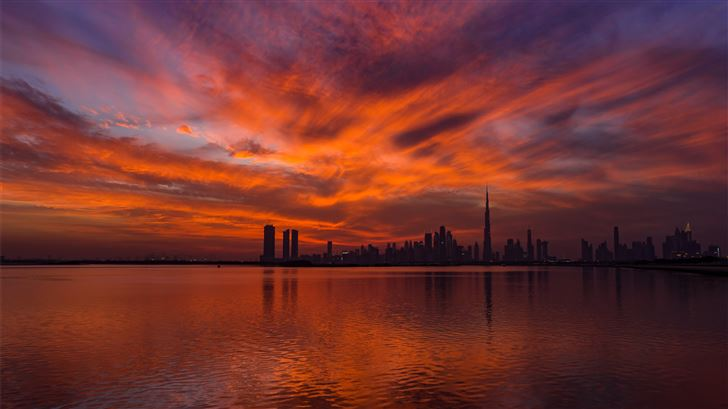 view of body of water near city during sunset Mac Wallpaper
