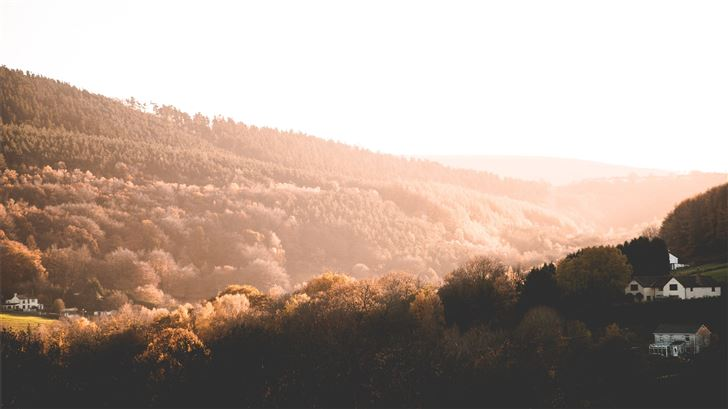 brown trees near mountains at daytime Mac Wallpaper