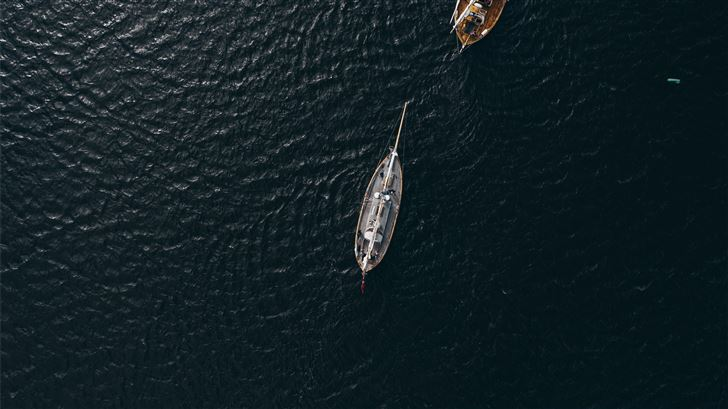 aerial view of white boat on body of water during  Mac Wallpaper
