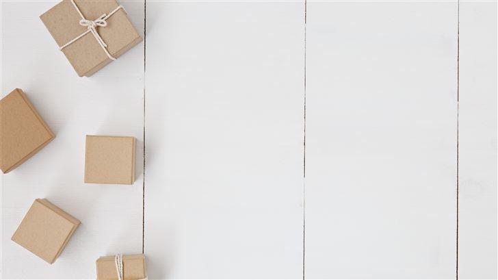 brown gift box on white surface Mac Wallpaper