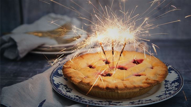 brown pie with sparklers on top Mac Wallpaper