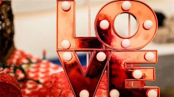 brown and white love lighted signage Mac Wallpaper