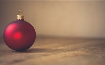 closeup photo of red ball ornament on surface All Mac wallpaper