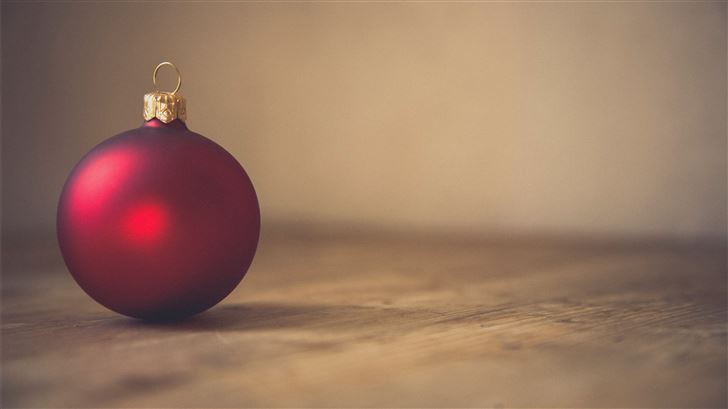 closeup photo of red ball ornament on surface Mac Wallpaper