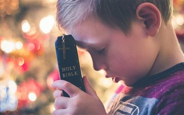 boy holding Holy Bible iMac wallpaper