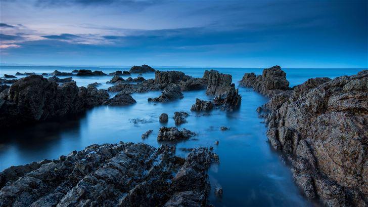 sea rocks evening view 5k Mac Wallpaper