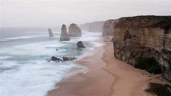 hazy beach evening 5k Mac Wallpaper