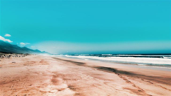 seashore under clear blue sky 5k Mac Wallpaper