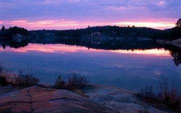 Rocky lake shore Mac wallpaper