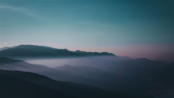 early morning fog sky mountains Mac Wallpaper