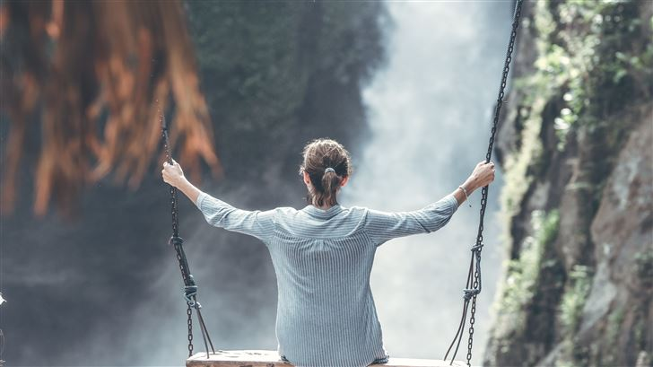 woman swings near waterfall 5k Mac Wallpaper