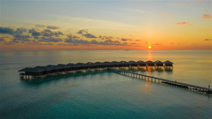 aerial photography of above water huts and bridge  Mac Wallpaper