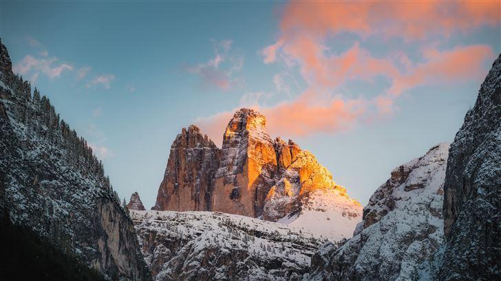brown rocky mountains under blue sky 8k Mac Wallpaper