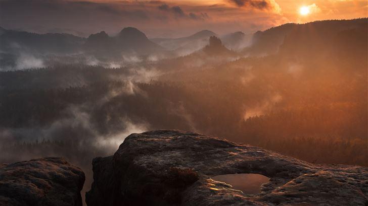 rock hill fog clouds forest sunset 5k Mac Wallpaper