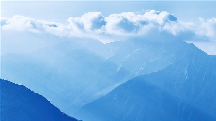 silhouette of mountains under cloudy sky 5k Mac Wallpaper