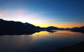 Sunset over mountain lake All Mac wallpaper
