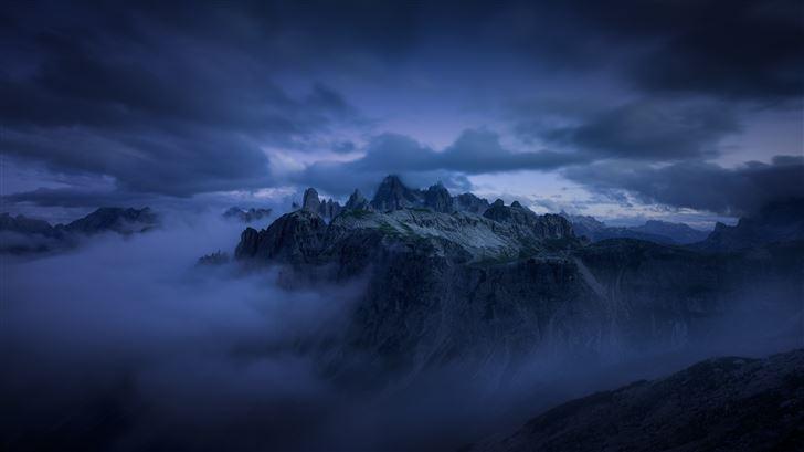 mountains cliff covered under fog mist 5k Mac Wallpaper