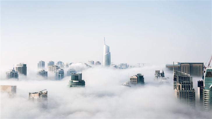 skyscraper buildings covered in fog Mac Wallpaper