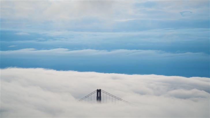 aerial view of bridge under clouds 8k Mac Wallpaper