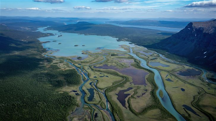 aerial view green mountains 8k Mac Wallpaper