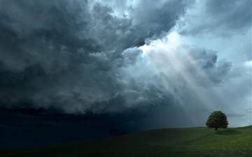 Storm cloud sun rays All Mac wallpaper