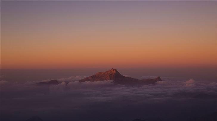 mountain peak from clouds 5k Mac Wallpaper