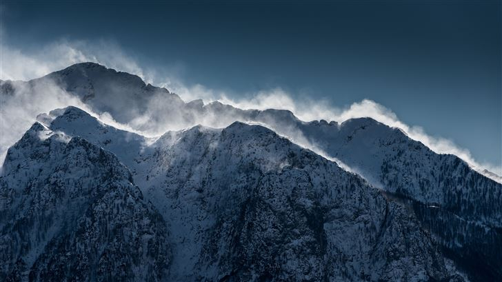 clouds over snow mountain range cliff Mac Wallpaper