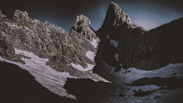 dark mountains covered by snow 5k Mac Wallpaper