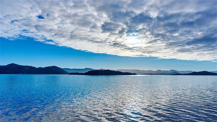 vibrant clouds over lake seascape Mac Wallpaper