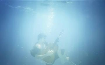 Playing Guitar Underwater Mac wallpaper